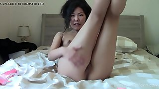 Naughty asian stretches her gams and masturbates passionately