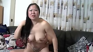 Asian amateur help fucked in their living room